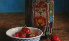Bowl of strawberries with old tin